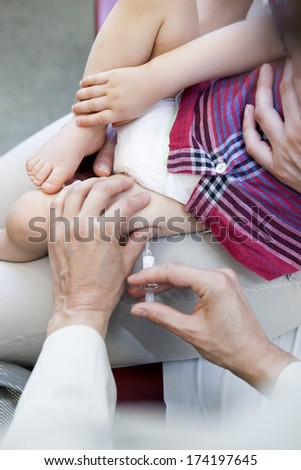 Vaccinating A Child - stock photo