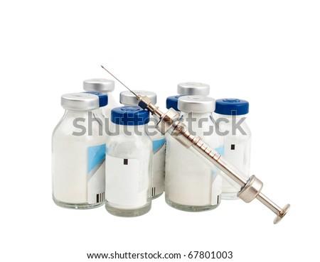vaccine and syringe on white background - stock photo