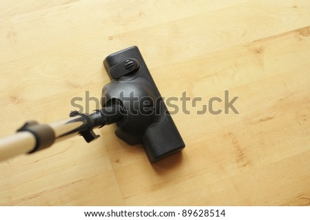 vacuum cleaner and copyspace showing housework or domestic life concept