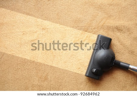 vacuum cleaner and copyspace showing housework or domestic life concept - stock photo