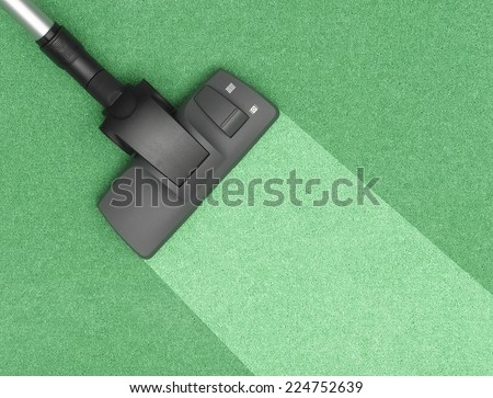 Vacuum Cleaner cleaning the carpet - stock photo