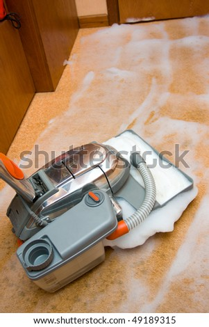 Vacuum cleaner in action - stock photo