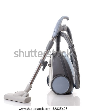 vacuum cleaner isolated over white - stock photo