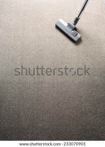 Vacuum cleaner on a carpet with copy space