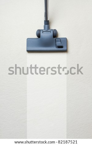 Vacuum cleaner on dirty carpet with copy space - stock photo