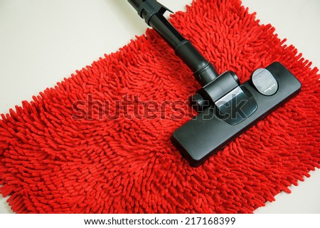 Vacuum cleaner on Red Carpet - stock photo
