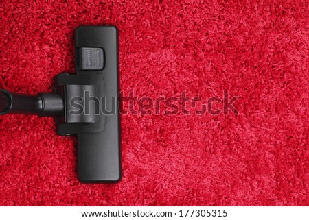 Vacuum cleaner on Red Carpet Top View - stock photo