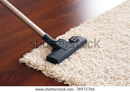 Vacuum cleaner to tidy up. - stock photo