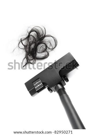 Vacuum cleaning fall hair on white background - stock photo