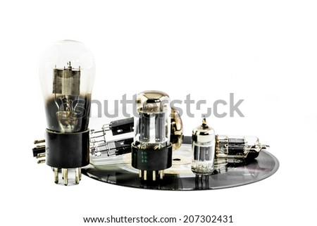 Vacuum electronic preamplifier tubes on platter . Isolated image on white background - stock photo