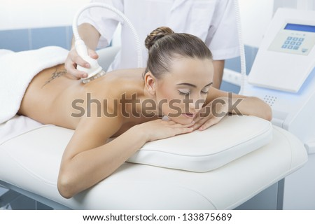 vacuum massage procedure in the medical beauty center - stock photo