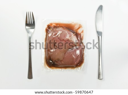 Vacuum-packed meat - stock photo