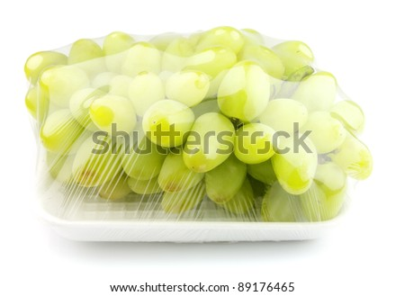 vacuum packed sweet grapes on a white background - stock photo