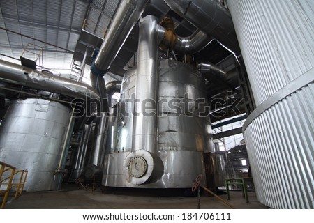 vacuum pans evaporator equipment in a sugar mill - stock photo