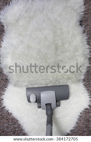 vacuuming  carpet - stock photo
