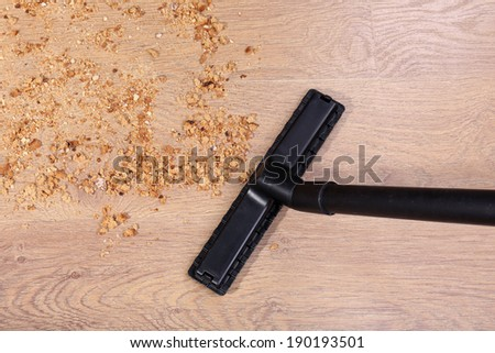 Vacuuming floor in house - stock photo