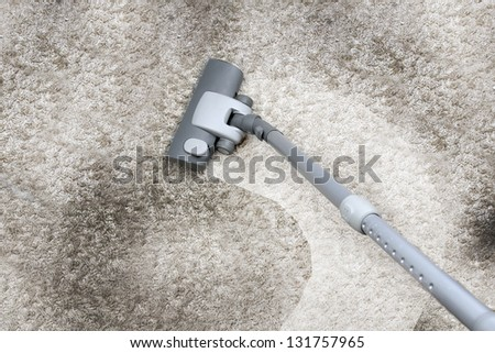 Vacuuming the carpet - stock photo