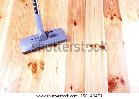 vacuuming wooden flor - stock photo