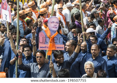VADODARA, GUJARAT/INDIA - 9 April 2014 : Large crowd waiting for Gujarat Chief Minister and BJP prime ministerial candidate Narendra Modi to arrive on 9th april in Vadodara, Gujarat.