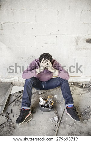 Vagabond with fire in squat, crises - stock photo