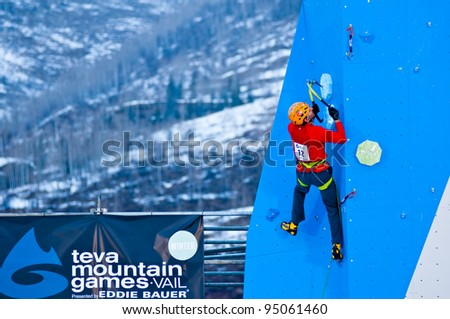 VAIL, CO - FEB 10: Sam Elias on route winning the mixed climbing, male, at Teva Mountain Games first winter competition in Vail, CO. on Feb 10, 2012 - stock photo