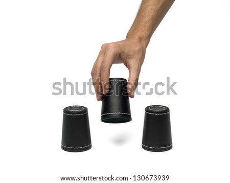 Vaious dice cups with hand on isolated white background - stock photo
