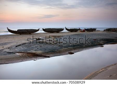 Vakala beach with fishing ships at the sunset - stock photo