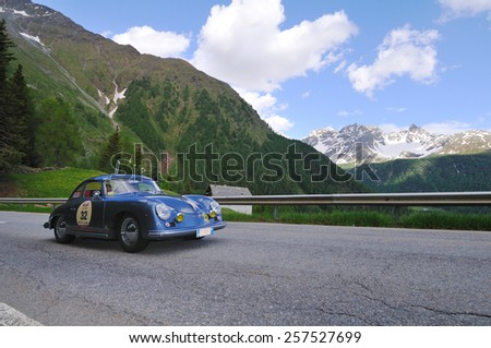 VAL DI POSCHIAVO, SWITZERLAND - JUNE 13: A blue Porsche 356 A T1 takes part to the Summer Marathon classic car race on June 13, 2014 in Val di Poschiavo. This car was built in 1956 - stock photo