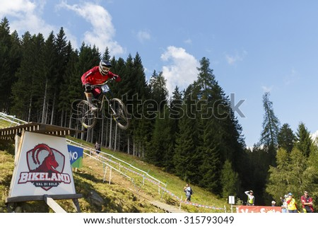 Val Di Sole, Italy - 22 August 2015: Intense Factory Racing Team,  Rider Cometti Luca in action during the mens elite Downhill final World Cup at the Uci Mountain Bike in Val di Sole, Trento, Italy