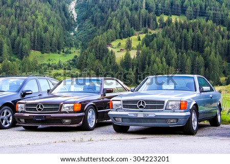 VALAIS, SWITZERLAND - AUGUST 5, 2014: Motor cars Mercedes Benz W126 SEC-class at the used cars trade center. - stock photo