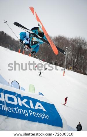 VALCA, SLOVAKIA - FEBRUARY 13: jump of  Adam Cagan at Nokia Freestyle Tour 2011 February 13, 2011 in Valca, Slovakia - stock photo