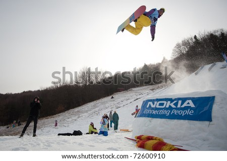 VALCA, SLOVAKIA - FEBRUARY 13: jump of  Anders Haugvad at Nokia Freestyle Tour 2011 February 13, 2011 in Valca, Slovakia - stock photo