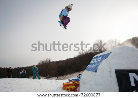 VALCA, SLOVAKIA - FEBRUARY 13: jump of  Dusan Bizik at Nokia Freestyle Tour 2011 February 13, 2011 in Valca, Slovakia - stock photo