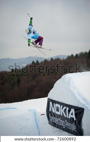 VALCA, SLOVAKIA - FEBRUARY 13: jump of  Juraj Bernat in final round of Nokia Freestyle Tour 2011 on February 13, 2011 in Valca, Slovakia - stock photo