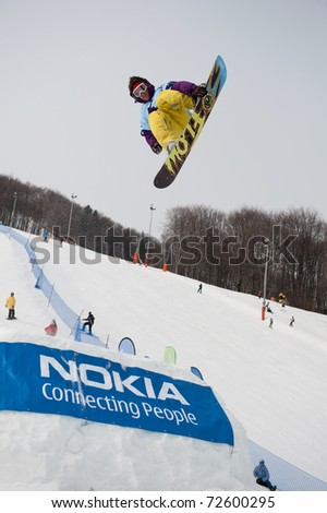 VALCA, SLOVAKIA - FEBRUARY 13: jump of  Tomas Kral at Nokia Freestyle Tour 2011 February 13, 2011 in Valca, Slovakia - stock photo