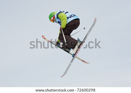 VALCA, SLOVAKIA - FEBRUARY 13: jump of  unknown competitor at Nokia Freestyle Tour 2011 February 13, 2011 in Valca, Slovakia - stock photo