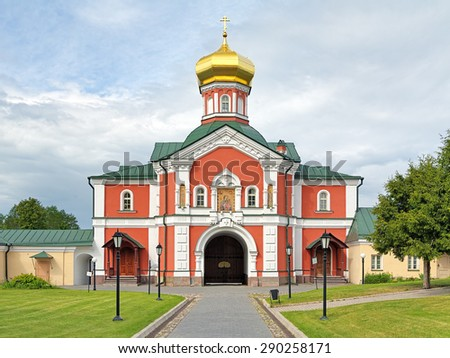 VALDAY, RUSSIA - JUNE 11, 2015: Gate Church of Saint Philip, Metropolitan of Moscow, with Icon of Theotocos Iverskaya (Panagia Portaitissa) in Valday Iversky Monastery. Church was built in 1873-1874. - stock photo