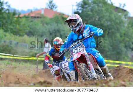 VALDESOTO, SPAIN - AUGUST 8: Asturias Motocross Championship in August 8, 2015 in Valdesoto, Spain. Christian Alvarez rider with the number 56.