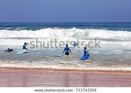 VALE FIGUEIRAS, PORTUGAL - 20th AUGUST 2017: Surfers getting surfers lessons at Vale Figueiras beach in Portugal on august 20, 2017