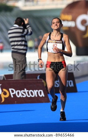 VALENCIA - NOVEMBER 27: Marta Esteban (number 82) finalizing the womens marathon race in second position at finish line in Valencias Marathon on November 27, 2011 in Valencia, Spain