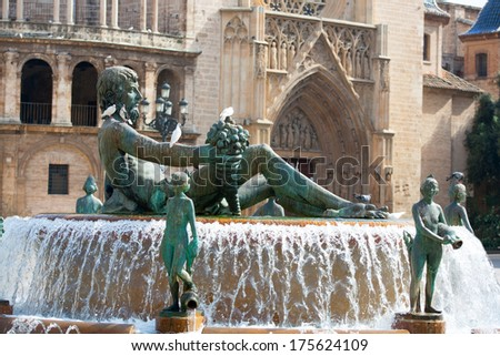 Valencia Plaza de la virgen square with Neptuno fountain and Cathedral at Spain - stock photo