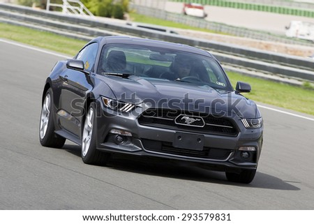 VALENCIA, SPAIN - APRIL 25: A grey 2015 Ford Mustang take part in American Fest weekend organizated in circuit Ricardo Tormo, on April 25, 2015, in Cheste, Valencia, Spain.