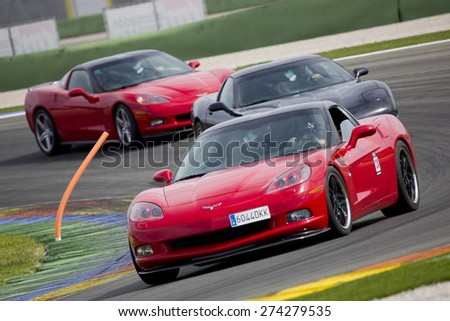 VALENCIA, SPAIN - APRIL 25: A red Chevrolet Corvette C6 take part in American Fest weekend organizated in circuit Ricardo Tormo, on April 25, 2015, in Cheste, Valencia, Spain. - stock photo