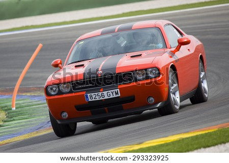VALENCIA, SPAIN - APRIL 25: A red Dodge Challenger RT take part in American Fest weekend organizated in circuit Ricardo Tormo, on April 25, 2015, in Cheste, Valencia, Spain.