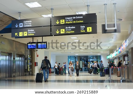 VALENCIA, SPAIN - APRIL 13, 2015: Airline passengers inside the Valencia Airport. About 4.59 million passengers passed through the airport in 2013. - stock photo