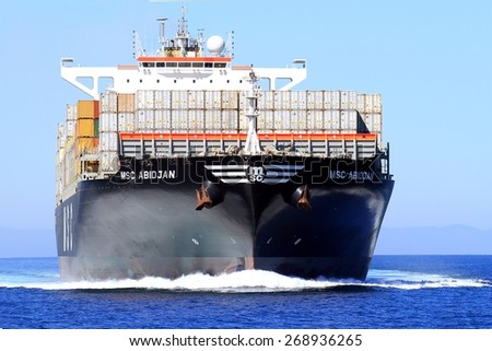"""VALENCIA, SPAIN -?? APRIL 09: Bow view of the container ship """"MSC ABIDJAN"""" after leaving the port of Valencia is sailing in open waters, on april 09, 2015 in Valencia. - stock photo"""