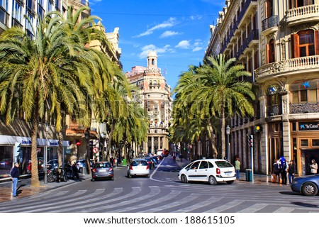 VALENCIA, SPAIN - APRIL 4 : Center of Valencia city with Bank of Valencia, big buildings and cars and people moving around on April 4th, 2014 in Valencia, Spain - stock photo