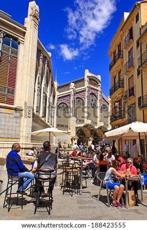 VALENCIA, SPAIN - APRIL 5 : People enjoying sunshine in the outdoor cafe in front of the Mercado Central - main food market of Valencia and one of the oldest European markets on April 5th, 2014. - stock photo