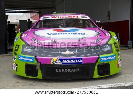 VALENCIA, SPAIN - APRIL 25: Simone Monforte compete at Race 1 Elite 1 of Nascar Whelen Euro Series in Ricardo Tormo circuit, on April 25, 2015 in Cheste, Valencia, Spain. The winner was Eddie Cheever. - stock photo