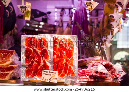 VALENCIA, SPAIN - APRIL 5th : Counter displaying typical, finely sliced, vacuum packed Iberian ham in the Valencia Central Market (Mercado Central) on April 5th, 2014 in Valencia, Spain.  - stock photo